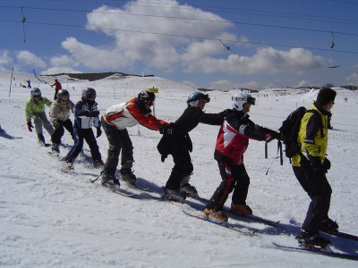 Family being taught to ski